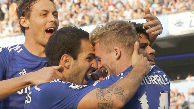 Chelsea's Schurrle celebrates with team mate Fabregas after scoring a goal against Manchester City during their English Premier League soccer match at the Etihad stadium in Manchester