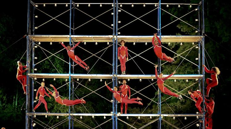 "This Sept. 16, 2013 image released by New York City Center shows the STREB Extreme Action Company performing its ""Human Fountain"" at the Delacorte Theatre in New York's Central Park as part of the 10th anniversary of the Fall for Dance Festival. (AP Photo/New York City Center, Tammy Shell)"