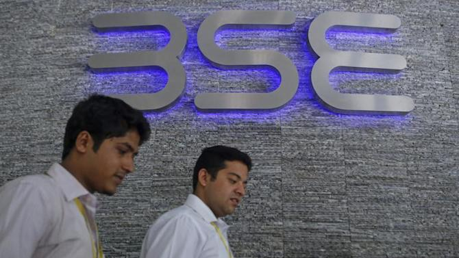 Employees walk out of the Bombay Stock Exchange (BSE) building in Mumbai
