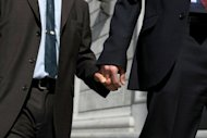 Same-sex couple hold hands in San Francisco, California on May 15, 2008. An Australian politician and his boyfriend are getting married in Spain after flying halfway round the world to take advantage of the country's gay marriage laws
