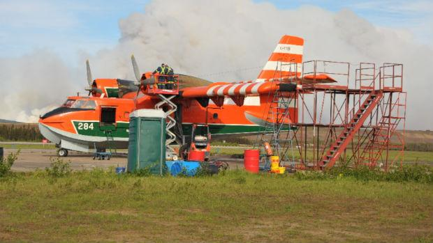 A water bomber used in the fight against the fires outside Wabush is seen refuelling last week at an airstrip.