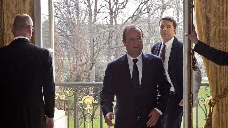 France's President Hollande and Italy's Prime Minister Renzi prior to a meeting at the Elysee Palace in Paris