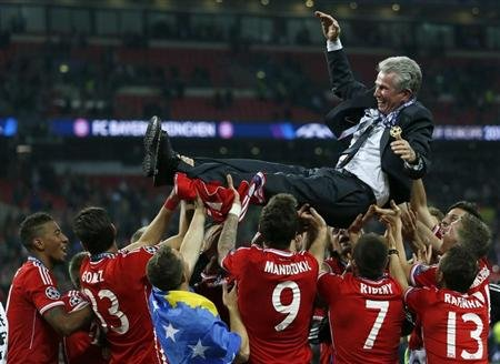 Bayern Munich players throw their coach Jupp Heynckes into the air as they celebrate winning the Champions League final soccer match at Wembley stadium in London May 25, 2013. Bayern Munich beat Borus