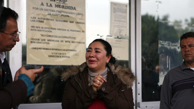 "Michelle Valadez, 34, whose husband Ignacio was kidnapped, held for three months and killed in 2005, allegedly by the gang led by the Mexican then boyfriend of Frenchwoman Florence Cassez, cries outside a prison where Cassez had been held in Mexico City, Wednesday, Jan. 23, 2013. A Mexican Supreme Court panel voted Wednesday to release Cassez, a Frenchwoman who says she was unjustly sentenced to 60 years in prison for kidnapping and whose case became a cause celebre in France, straining relations between the two countries. A police convoy with sirens flashing escorted a white sports utility vehicle out of the prison where Cassez had been held later Wednesday, presumably carrying her to the Mexico City airport. Relatives of kidnap victims angrily shouted ""Killer!"" as the vehicle pulled away. (AP Photo/Andres Leighton)"