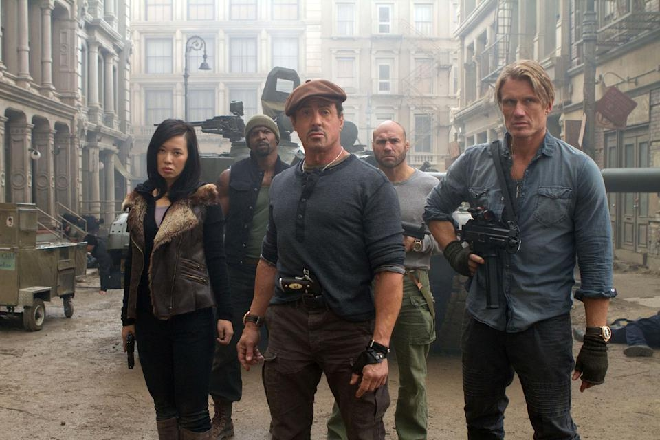 "This film image released by Lionsgate shows, from left, Yu Nan, Terry Crews, Sylvester Stallone, Randy Couture and Dolph Lundgren in a scene from ""The Expendables 2."" (AP Photo/Lionsgate-Millennium Films, Frank Masi)"