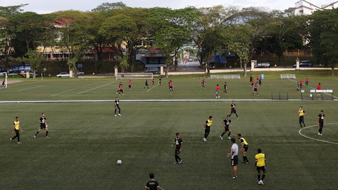 Member of Malaysia's under-13 National Football Development Programme take part in a training session in Kuala Lumpur, Malaysia