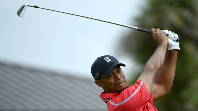 Tiger Woods tees off on the first hole during the final round of the Arnold Palmer Invitational golf tournament in Orlando, Fla., Sunday, March 24, 2013. (AP Photo/Phelan M. Ebenhack)