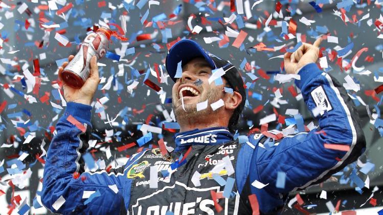 Jimmie Johnson celebrates after winning the Daytona 500 NASCAR Sprint Cup Series auto race, Sunday, Feb. 24, 2013, at Daytona International Speedway in Daytona Beach, Fla. (AP Photo/Terry Renna)