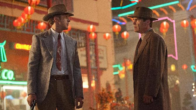 """This film image released by Warner Bros. Pictures shows  Ryan Gosling, left, as Sgt. Jerry Wooters, and Josh Brolin, as Sgt. John O'Mara in """"Gangster Squad."""" (AP Photo/Warner Bros. Pictures, Jamie Trueblood)"""