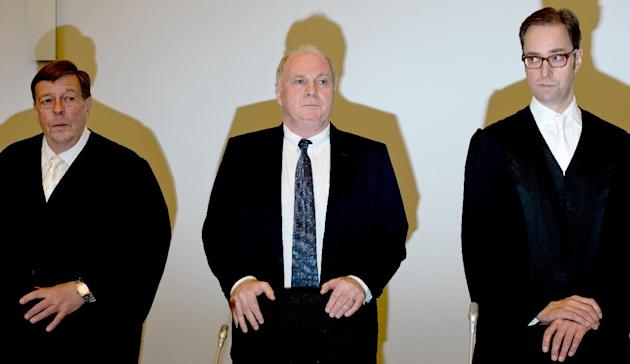 Bayern Munich President Uli Hoeness stands between his lawyers Hanns W. Feigen, left, and Markus Gotzens, right, before the start of the second day of his trial for tax evasion at the regional court i
