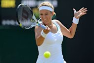 Belarus&#39;s Victoria Azarenka smashes a forehand shot during her third round women&#39;s singles victory over Slovakia&#39;s Jana Cepelova at the All England Tennis Club in Wimbledon, southwest London. Azarenka reached the Wimbledon last 16 with a 6-3, 6-3 win over Slovak qualifier Jana Cepelova