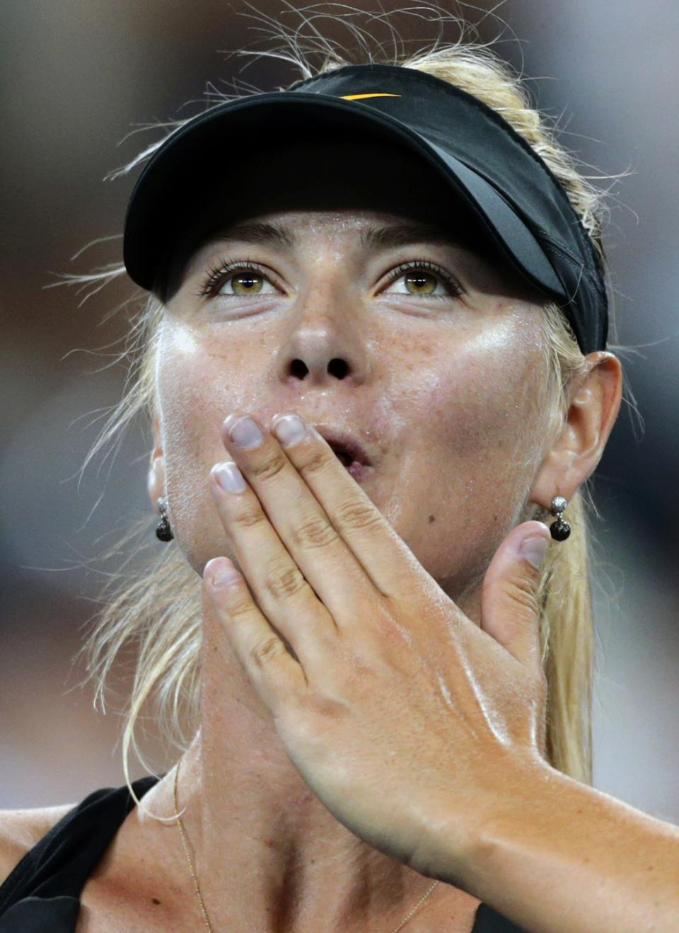 Maria Sharapova, of Russia, blows a kiss to the crowd after defeating Lourdes Dominguez Lino, of Spain, 6-0, 6-1 in the second round of play at the U.S. Open tennis tournament, Wednesday, Aug. 29, 2012, in New York. (AP Photo/Charles Krupa)