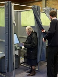 A woman looks at the voting computer at a polling station during the Belgian municipal and provincial elections in Brugge. Flemish nationalist leader Bart De Wever scored a breakthrough election win Sunday and immediately urged Belgian Prime Minister Elio Di Rupo to radically re-shape the federal state