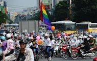 Cyclists decorated with balloons and rainbow flags take part in Vietnam's first ever gay pride parade, in Hanoi, on August 5. The event, organised by the city's small but growing Lesbian Gay Bisexual and Transgender (LGBT) community, went ahead peacefully with no attempt by police to stop the colourful convoy of about 100 activists