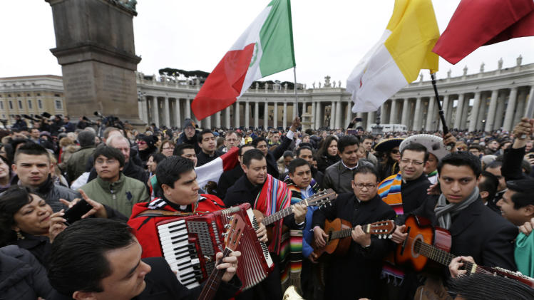 A band plays in St. Peter's Square as they wait for the Angelus prayer with Pope Francis at the Vatican, Sunday, March 17, 2013. (AP Photo/Alessandra Tarantino)