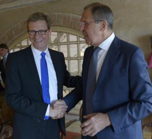 Russian Foreign Minister Sergey Lavrov, right, and German Foreign Minister Guido Westerwelle shake hands during their meeting on the eve of the ministers' session of the Council of the Baltic Sea States in Kaliningrad, western Russia, Wednesday, June 5, 2013. (AP Photo/Pool)