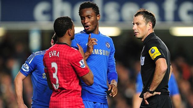 Match referee Mark Clattenburg (right) speaks with Chelsea's Mikel (centre) and Manchester United's Patrice Evra (left)