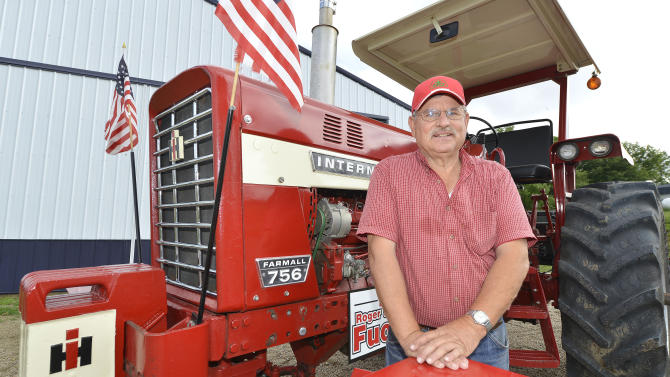 Roger Fuoss is shown with his International Farmall 756 tractor at his rural Wayne, Neb., farm Wednesday, June 4, 2014. Fuoss and his wife, Carol participate in numerous tractor rides throughout the year and will ride in this weekend's Great Nebraska Tractor Ride in northeast Nebraska. (AP Photo/Sioux City Journal, Tim Hynds)