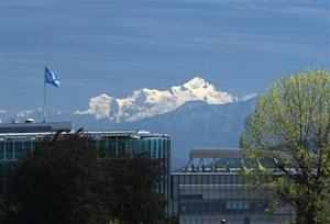 A U.N. flag is pictured on the top of the WMO building with the Mont-Blanc massif in the background in Geneva