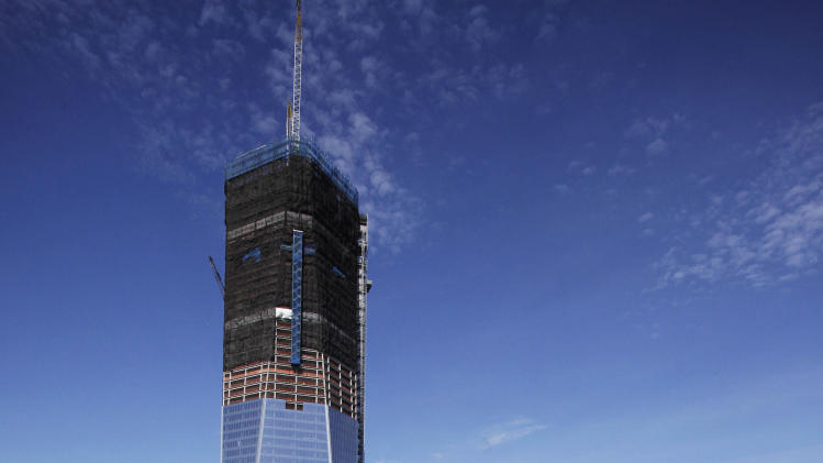 FILE - In this April 17, 2012 file photo, One World Trade Center rises above the lower Manhattan skyline and the National September 11 Memorial and Museum, in New York. Eleven years after terrorists attacked the World Trade Center, the new World Trade Center now dominates the lower Manhattan skyline. (AP Photo/Mark Lennihan, File)