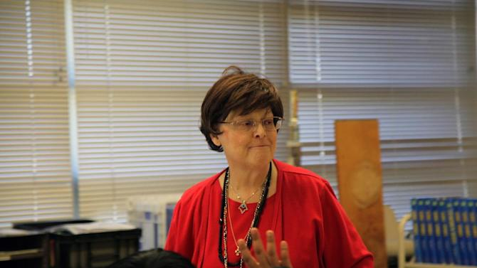 In this March 20, 2013 photo, Susan Templer talks with her students about their achievement tests in Richardson, Texas. Templer was diagnosed with pancreatic cancer in 2011, but has continued teacher through her illness to reach her 25 year service mark. (AP Photo/John L. Mone)