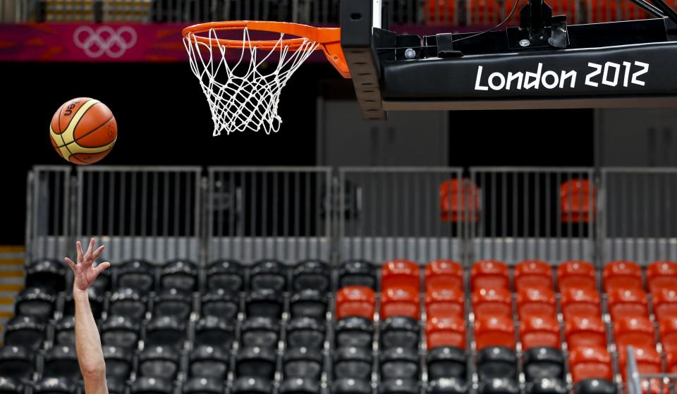 Sports specialist Joel Fitzpatrick plays basketball at the Basketball Arena at the Olympic Park, Tuesday, July 24, 2012, in London. Opening ceremonies for the 2012 London Olympics will be held Friday, July 27. (AP Photo/Jae C. Hong)