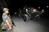 Philippine soldiers aboard an armored personnel carrier in Mindanao in 2010. The Philippine military said Sunday it would put four senior special forces officers on trial over a botched mission against Muslim insurgents that left 19 commandos dead and almost scuppered peace talks