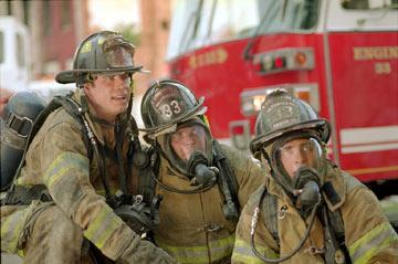 John Travolta , Kevin Chapman and Joaquin Phoenix in Touchstone's Ladder 49