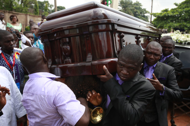 Pallbearers carry the coffin of  late author Chinua Achebe at his funeral service, held at St. Philip's Anglican Church in  Ogidi, Nigeria, Thursday, May 23, 2013. Writer Chinua Achebe shunned Nigeria