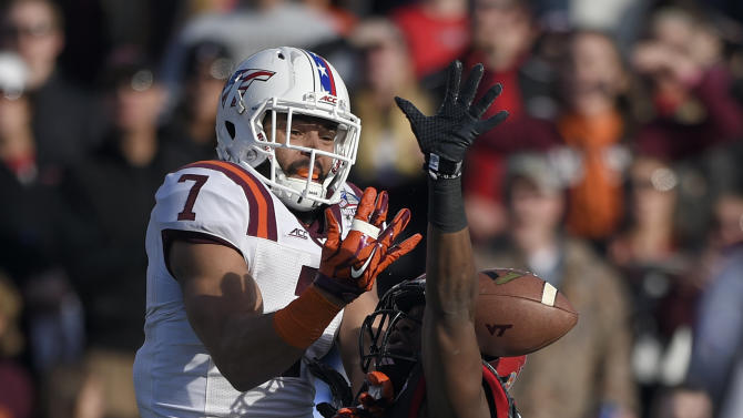 Virginia Tech tight end Bucky Hodges (7) and Cincinnati safety Zach Edwards, right, battle for the ball during the first half of the Military Bowl NCAA college football game, Saturday, Dec. 27, 2014, in Annapolis, Md. Cincinnati was called for pass interference on the play. (AP Photo/Nick Wass)