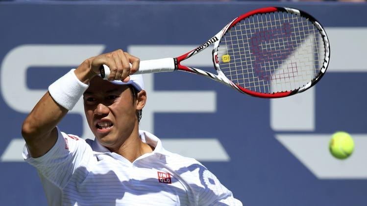 Kei Nishikori of Japan hits a return to Pablop Andujar of Spain during their match at the 2014 U.S. Open tennis tournament in New York