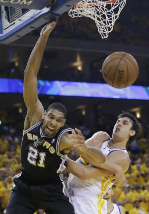 San Antonio Spurs' Tim Duncan, left, battles for a rebound against Golden State Warriors' Andrew Bogut during the second half of Game 3 of a Western Conference semifinal NBA basketball playoff series in Oakland, Calif., Friday, May 10, 2013. San Antonio won 102-92. (AP Photo/Marcio Jose Sanchez).