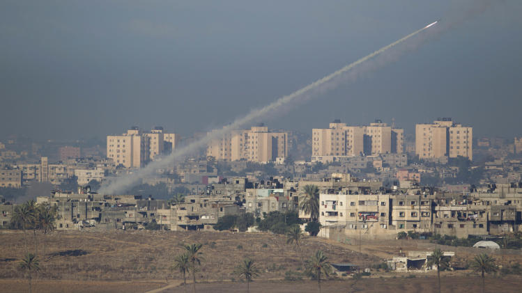 A rocket launched by Palestinian militants towards Israel makes its way from the northern Gaza Strip, seen from the Israel Gaza Border, southern Israel, Thursday, Nov. 15, 2012. (AP Photo/Ariel Schalit)
