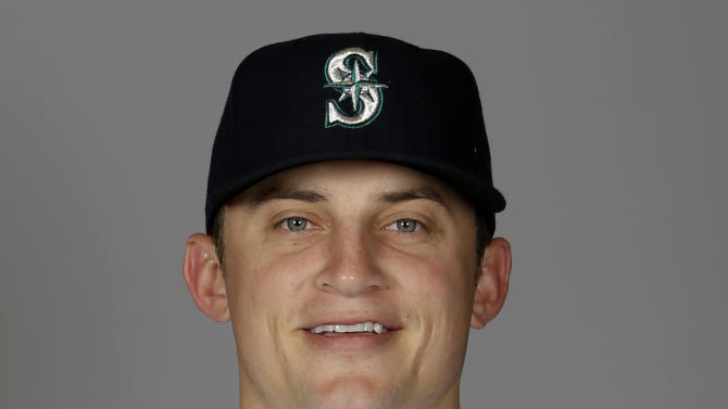 FILE - This is a 2014, file photo showing Kyle Seager of the Seattle Mariners baseball team. A person with knowledge of the deal says the Seattle Mariners and All-Star third baseman Kyle Seager have agreed to a $100 million, seven-year contract.  The person spoke to The Associated Press on Monday, Nov. 24, 2014,  on the condition of anonymity because the deal is pending a physical.  (AP Photo/Tony Gutierrez, File)