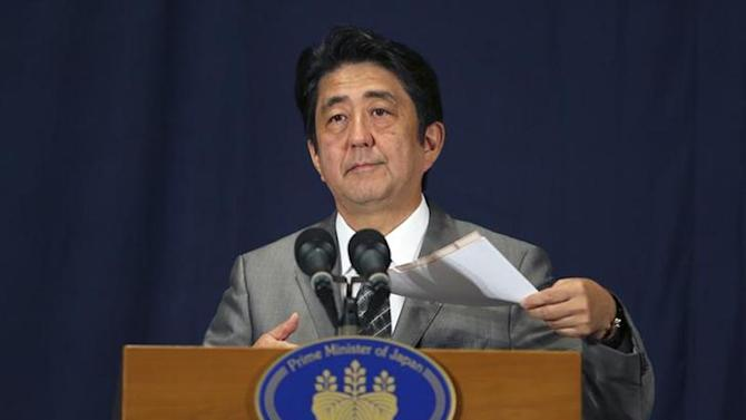 Japan's Prime Minister Shinzo Abe speaks during a news conference in Doha August 28, 2013. REUTERS/Fadi Al-Assaad