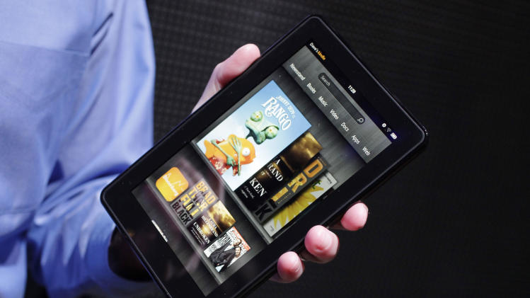 The Kindle Fire is shown at a news conference, Wednesday, Sept. 28, 2011 in New York. The e-reader and tablet has a 7-inch (17.78 cm) multicolor touchscreen and will go on sale for $199 on Nov. 15. (AP Photo/Mark Lennihan)