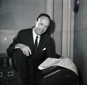 FILE - In this May 6, 1963 file photo, New York Times reporter Anthony Lewis reads about the Pulitzer Prizes while at the Boston bureau of The Associated Press, in Boston, as he won the year's Pulitzer Prize for national reporting. Two-time Pulitzer winner Lewis, whose New York Times column championed liberal causes for three decades, died Monday, March 25, 2013. He was 85. (AP Photo/File)