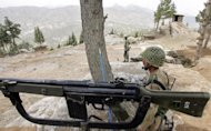This file photo shows Pakistani soldiers taking positions in the mountains of Shawal, along the Pakistan and Afghanistan border, in 2006. A US drone attack targeting a militant compound early on Saturday killed at least 10 insurgents in the troubled district, according to security officials
