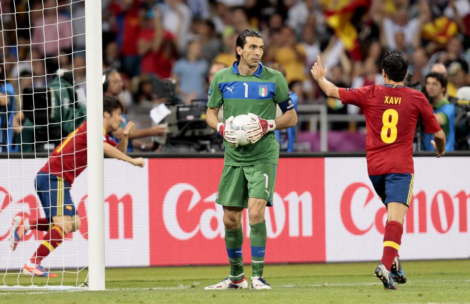 Italy's goalkeeper Gianluigi Buffon reacts after Spain's David Silva, left, scored the opening goal during the Euro 2012 soccer championship final  between Spain and Italy in Kiev, Ukraine, Sunday, July 1, 2012. (AP Photo/Ivan Sekretarev)