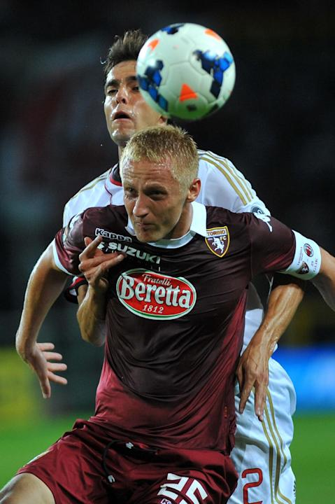 A.C. Milan Ricardo Kak of Brazil, challenges the ball with Torino' Kamil Glik of Poland, during a Serie A soccer match between Torino and  A.C. Milan at the Olympic stadium, in Turin, Italy, Saturday,