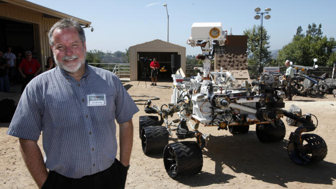 In this July  25, 2012 photo, Rob Manning, chief engineer, speaks to media at NASA Mars Yard at NASA's Jet Propulsion Laboratory in Pasadena Wednesday, July 25,  2012. Beside Manning is a model of the Mars rover, Curiosity. After traveling 8 1/2 months and 352 million miles, Curiosity will attempt a landing on Mars the night of Aug. 5, 2012. (AP Photo/Nick Ut)