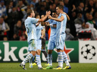 Manchester City's Aleksandar Kolarov, right, is congratulated by team mates after scoring a goal against Napoli during their Champions League Group A soccer match at the Etihad Stadium, Manchester, England, Wednesday Sept. 14, 2011. (AP Photo/Tim Hales)