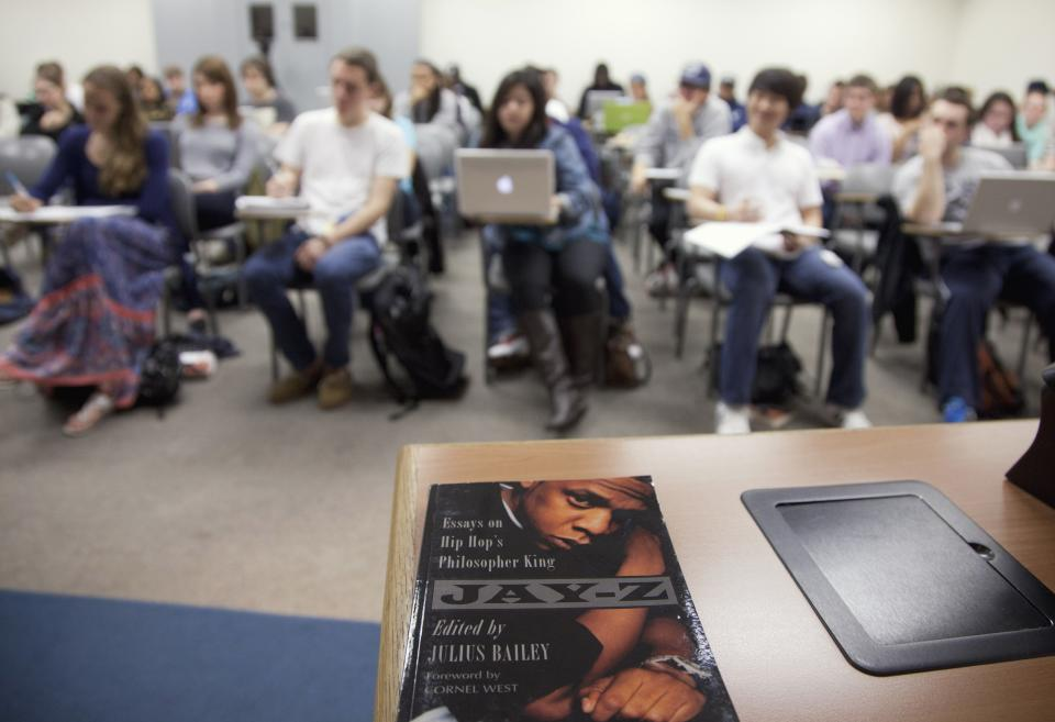 A textbook for professor Michael Eric Dyson sociology course at Georgetown University focusing on rapper Jay-Z, is seen in class, Monday, Nov. 28, 2011, in Washington.   (AP Photo/Evan Vucci)