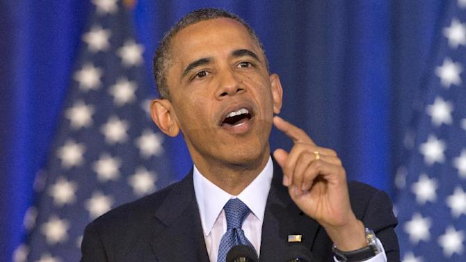 President Barack Obama reacts to a CODEPINK founder Medea Benjamin as she shouts at him from the back of the auditorium as he talked about national security, Thursday, May 23, 2013, at the National Defense University at Fort McNair in Washington. (AP Photo/Carolyn Kaster)