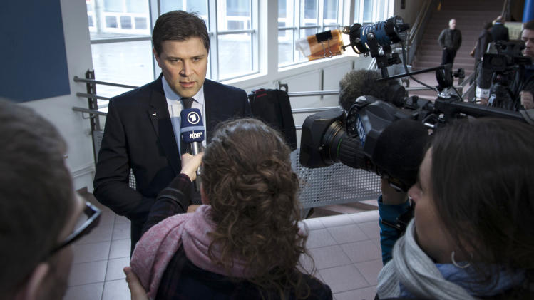 """Chairman of the Independence Party Bjarni Benediktsson talks to the media after casting his ballot in Reykjavik Saturday April 27, 2013, as Icelanders vote in a General Election.  According to polls the parliamentary election could return to power the center-right parties that led the country into economic collapse five-years ago, """"The government that many people thought was cleaning up the mess is getting severely punished for the last four years,"""" said political analyst Egill Helgason. (AP Photo/Brynjar Gauti)"""