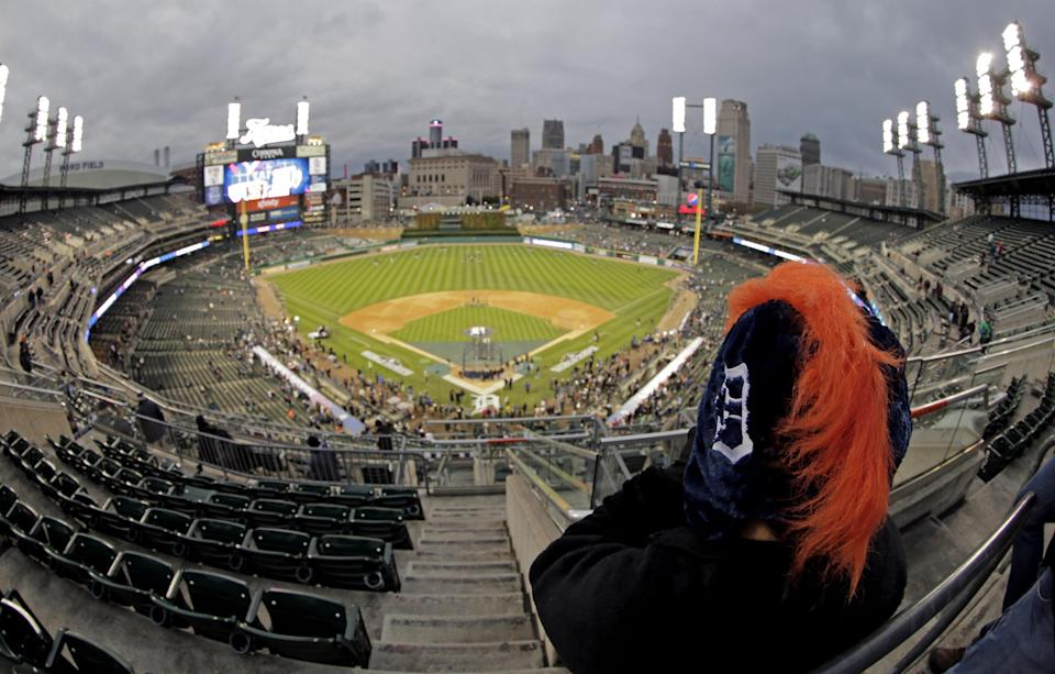 This image taken with a fisheye lens shows a Detroit Tigers fan watching batting practice before Game 4 of baseball's World Series against the San Francisco Giants Sunday, Oct. 28, 2012, in Detroit. (AP Photo/Charlie Riedel)