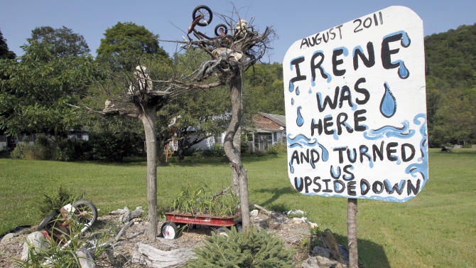 In this Aug. 17, 2012 photo, a sign remembers Tropical storm Irene in East Granville, Vt. A year ago, Vermont was devastated by the storm. Hard lessons have been learned in the year since Irene sent sedans bobbing down rivers, swept away historic covered bridges, put millions in the dark and killed more than 65 people all along the Eastern Seaboard. Responses range from personal gestures, like buying a home generator, to statewide policy changes, like the tightening of utility regulations. Many of the reactions are based on the belief that while Irene surprised areas more used to blizzards than tropical weather, future storms are inevitable. (AP Photo/Toby Talbot)