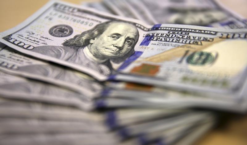 Correction - Dollar hits eight-month high on rate expectations, metals drop