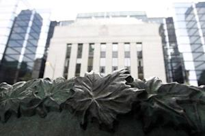 A sign framed by maple leaves is pictured in front of the Bank of Canada building in Ottawa