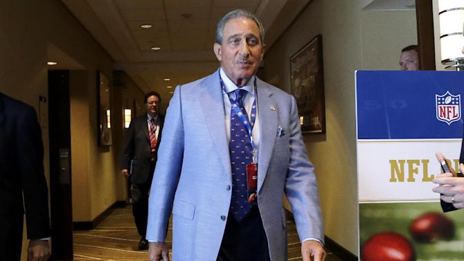Atlanta Falcons football team owner Arthur Blank walks through a hotel during a break in the NFL spring meeting in Boston, Tuesday, May 21, 2013. (AP Photo/Elise Amendola)